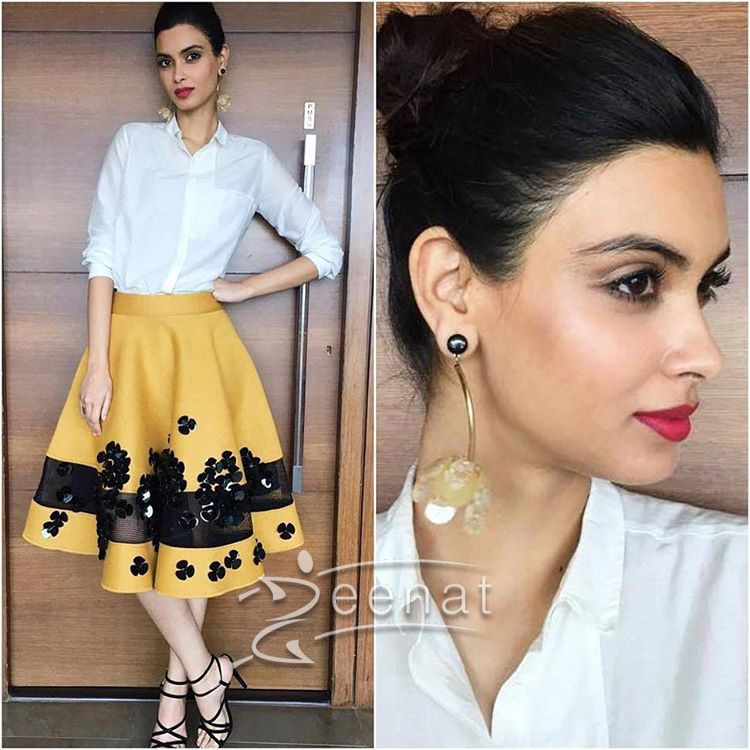 Here she paired this shirt from Bodice with an elegant skater skirt from Dhurv Kapoor. Tie-up heels from Intoto and earring from Mango.
