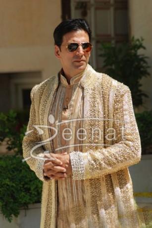 akshay wears a golden sherwani