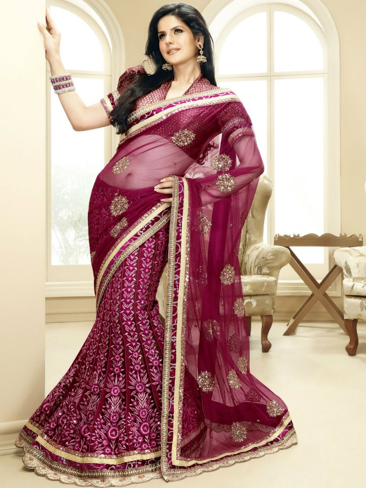 Zarine Khan In Magenta Net Lehenga Saree