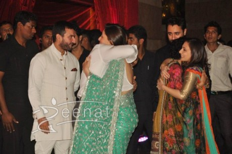 Aamir Khan hugging Kareena Kapoor at Ritesh Deshmukh Genelia Wedding Reception at Hotel Grand Hyatt in Mumbai