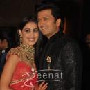 Ritesh Deshmukh &Genelia posing together at their wedding reception in Mumbai