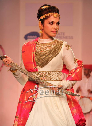 Isha Koppikar in white Anarkali Churidar