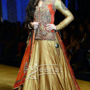 Nargis dazzled the runway in a golden lehenga at the India Bridal Fashion Week