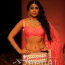 Shriya Saran Showcasing Her Toned Figure In Sexy Lehenga Choli At Lakme Fashion Week 2013