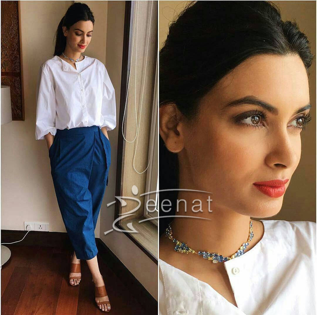 DianaPenty in a LovebirdsDesigns shirt, BodiceBodice pants and MaithiliKabre necklace.